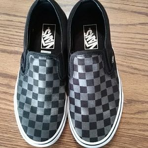 Checkered slate and black vans.